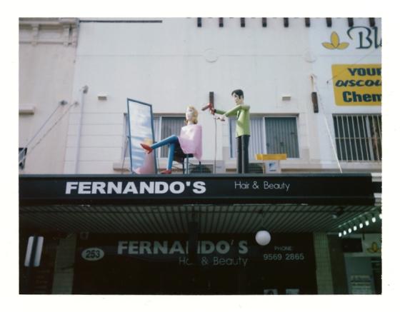 Polaroid of the weird business sculptures along Marrickville Road: Marrickville, Australia