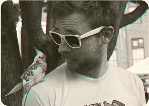 Sydney Designer Daniel Cozens and his cockatiel at the Glebe Markets