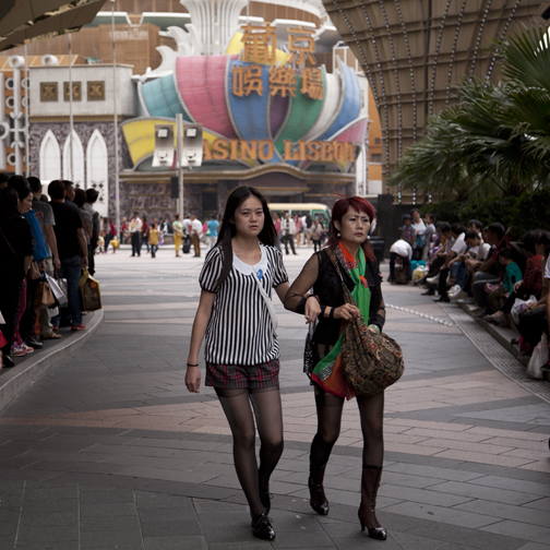 Two women walking outside the entrance of the Grand Lisboa, Macau