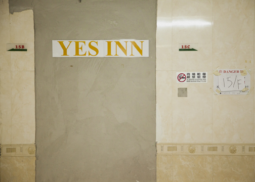The sign to the Yes Inn inside the Continental Mansion, Hong Kong