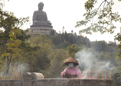 Women cleaning the incense urns at the Po Lin Monastery on Lantau Island, Hong Kong