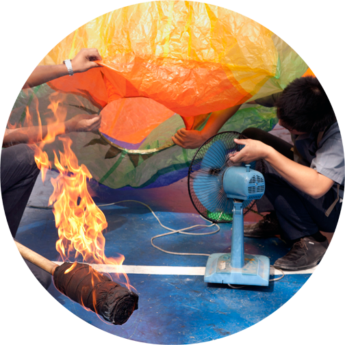 Students inflating their handmade lantern at the Chiang Mai Technical College during Yee Peng: Chiang Mai, Thailand