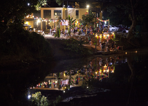 A bar on the the banks of the Ping River where people launched their krathongs: Chiang Mai, Thailand