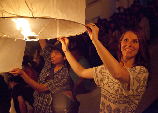 Tourists holding their lanterns during the Yee Peng Lantern Festival: Chiang Mai, Thailand