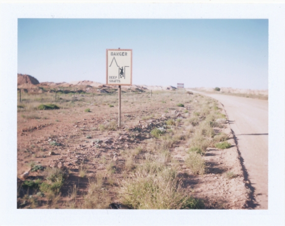 Polaroid of a warning sign in the mine fields: Coober Pedy, South Australia
