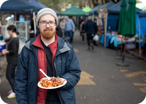 Barret enjoying the Fritter House at the Marrickville Markets: Sydney, Australia