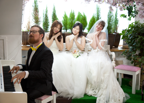 Barret playing the piano at a dress cafe in Ehwa: Seoul, South Korea