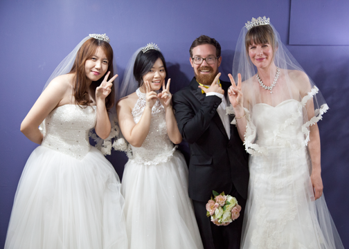 The group posing with a boquet at a dress cafe in Ehwa: Seoul, South Korea