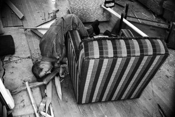 "Loomis Dean—Time & Life Pictures/Getty Images. Caption from LIFE. ""Fallen mannequin in house 5,500 feet from bomb is presumed dead."""