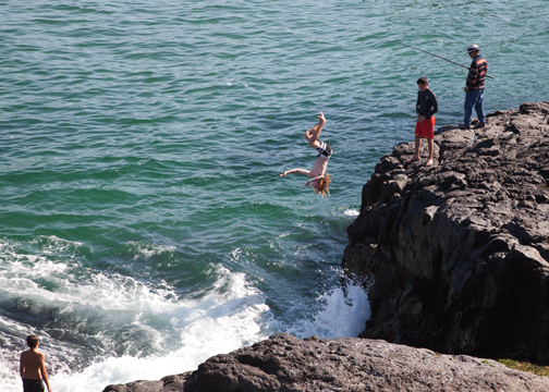 Boy cliff jumping in Kiama, NSW: Australia