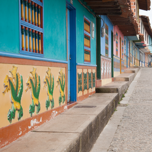 Row of painted houses with zocalos: Guatape, Colombia