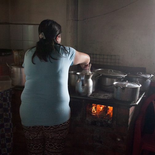 Woman making hot chocolate at the Finca la Montana: Valle de Cocora, Colombia