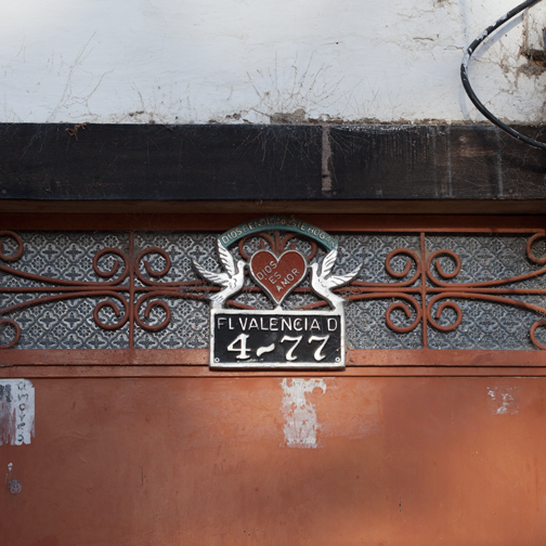 A religious house number marker in the colonial town of Salamina, Colombia