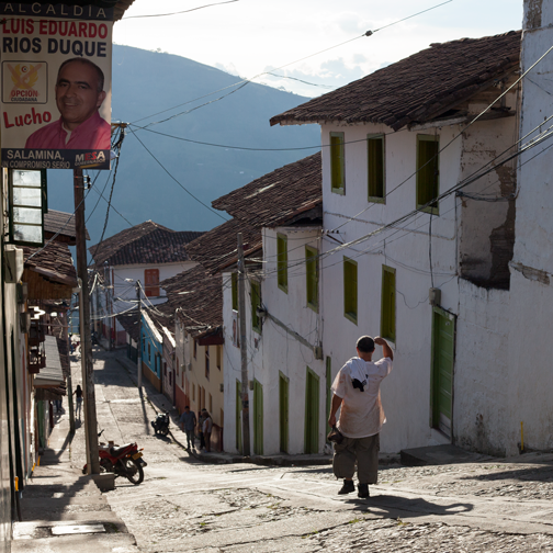 A man walking home in the late afternoon in the colonial town of Salamina, Colombia