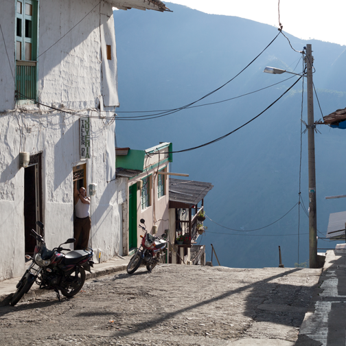 A street in Salamina that looks like it drops off into a valley: Colombia