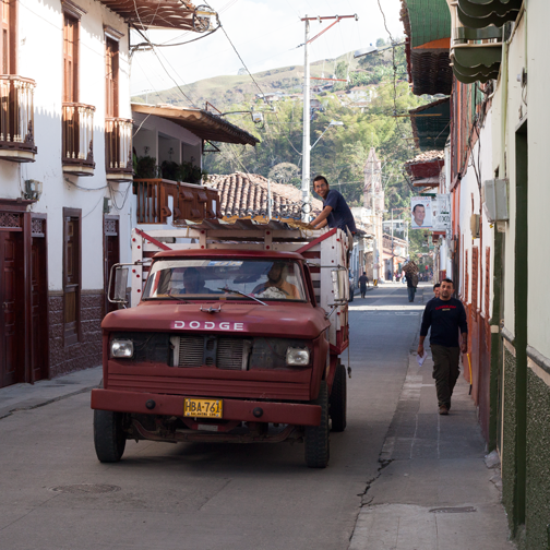 An antique truck driving down the colonial streets of Salamina, Colombia