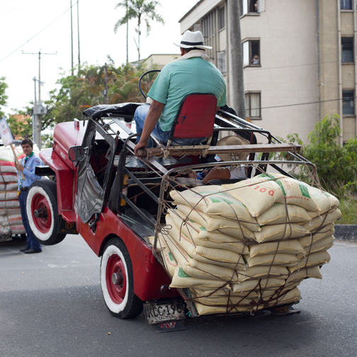 Yipao-Parade-Willys Jeep popping a willy and loaded with cargo: Armenia, Colombia