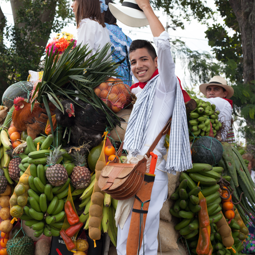 Yipao-Parade-Willys Jeep loaded with fruit and people in traditional costumes: Armenia, Colombia