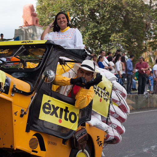 Yipao-Parade-Willys Jeep in the acrobatic group and driver back in the car adjusting his gloves: Armenia, Colombia