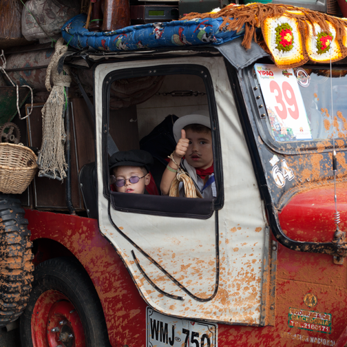 Yipao-Parade-Willys Jeep loaded with furniture and a sleeping child: Armenia, Colombia