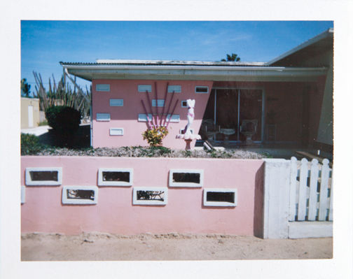 Polaroid of a pink bungalow house in Aruba