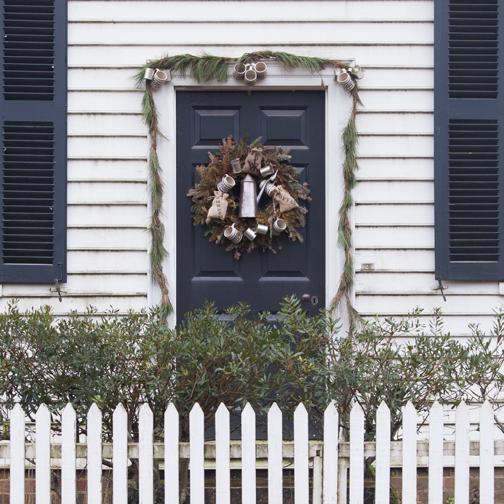 A door trimmed with Christmas decorations in Colonial Williamsburg, Virginia