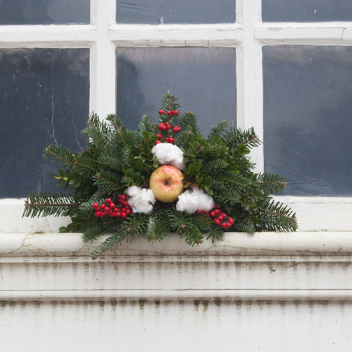 A window decorated for Christmas in Colonial Williamsburg, Virginia
