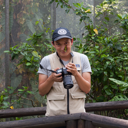 Photographer inside the butterfly garden at the Quindio Botanic Garden: Calarca, Colombia