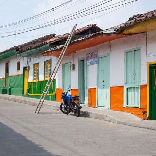 View of colorful buildings on the main street in Belalcazar: Colombia