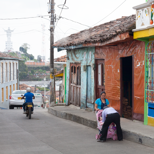 View of Cristo Rey statue and colorful buildings in Belalcazar: Colombia